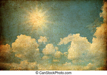 Grunge image of sky with clouds and sun