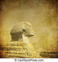 grunge image of sphynx and pyramid