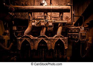 Grunge machinery in industrial surroundings