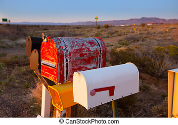 Grunge mail boxes in a row at Arizona desert USA
