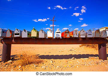 Grunge mail boxes in California Mohave desert USA