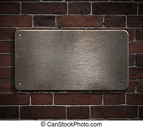 grunge metal plate with rivets on brick wall background