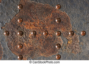 Grunge metal texture with rivets