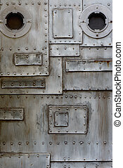 grunge metal with porthole - close up of metal wall with ...