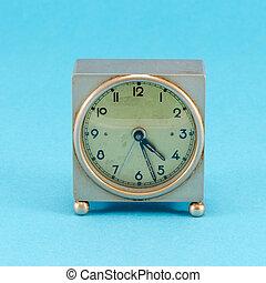 grunge metallic retro clock stand blue background