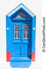 Grunge old blue doors in Oia town, Santorini, Greece.