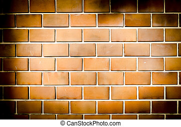 Grunge orange brick wall, dark tone