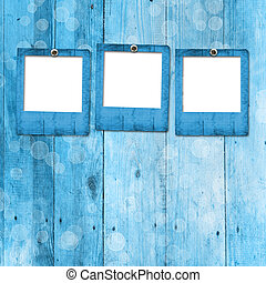 Grunge paper frame on the wooden background