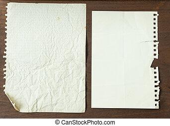 Grunge paper on wood background