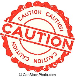 Grunge red caution word round rubber seal stamp on white background