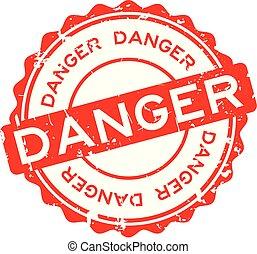 Grunge red danger word round rubber seal stamp on white background
