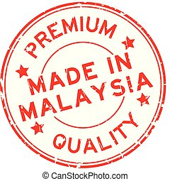 Grunge red premium quality made in Malaysia round rubber seal stamp on white background