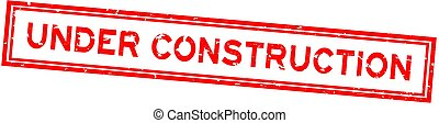 Grunge red under construction word square rubber seal stamp on white background
