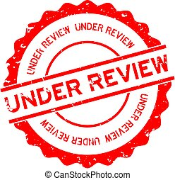 Grunge red under review word round rubber seal stamp on white background