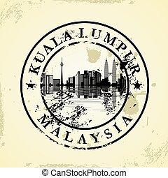 Grunge rubber stamp with Kuala Lumpur, Malaysia - vector...