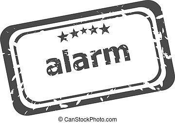 Grunge rubber stamp with word alarm inside
