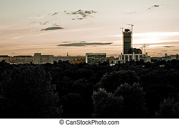 Grunge scene with Wroclaw's skyscrapers during the sunset