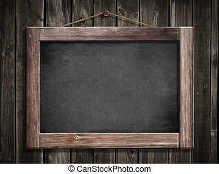 Grunge small blackboard hanging on wooden wall as a ...