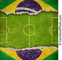 Grunge soccer or football field and flag of Brazil