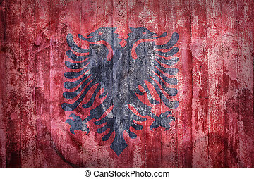 Grunge style of Albania flag on a brick wall