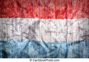 Grunge style of Luxembourg flag on a brick wall