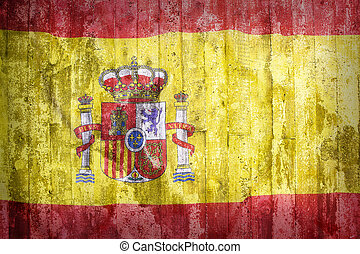 Grunge style of Spain flag on a brick wall