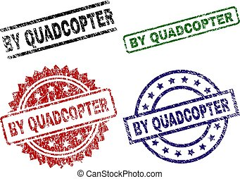 BY QUADCOPTER seal prints with damaged texture. Black, green, red, blue vector rubber prints of BY QUADCOPTER label with unclean texture. Rubber seals with round, rectangle, rosette shapes.
