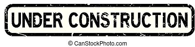 Grunge under construction square rubber seal stamp on white background