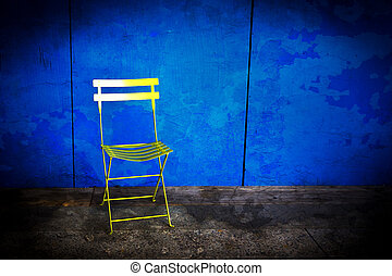 Grunge Wall and Chair - Grungy blue wall with a folding...