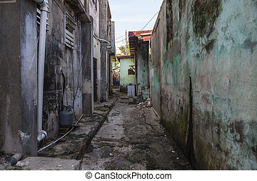 Grungy narrow dangerous looking barrio back alley.
