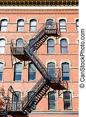 Grungy Black Fire Escape on Brick Building