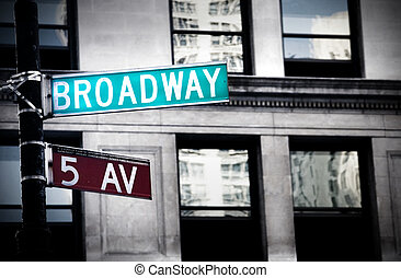 Broadway sign in New York City with grungy high contrast coloring