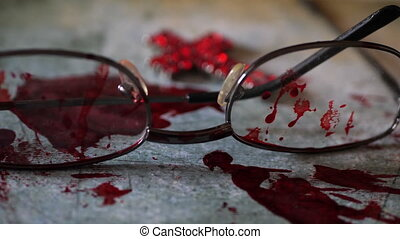 Grungy conceptual crime scene with blood and glasses