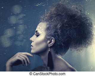 Grungy fashionable female portrait with copy space