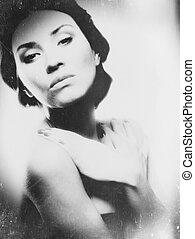 Grungy female portrait with soft focus lens