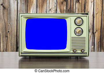 Grungy Green Vintage Television with Wood Wall and Chroma Key Bl