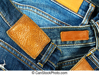 Grungy leather label on jeans - Brown grungy leather label...