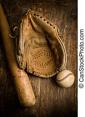 Grungy old baseball gloves and ball