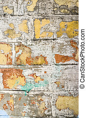 Grungy old paint on brick wall.