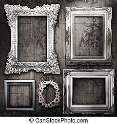 grungy room with silver frames and Victorian wallpaper - A...