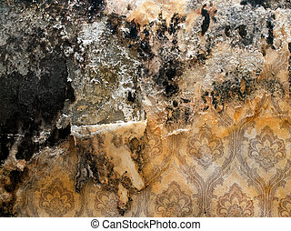 Grungy wall with shabby wallpaper closeup background.