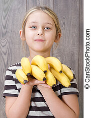 grupo, bananas, menina, segurando