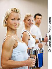 grupo de las personas, hacer, ejercicio salud, con, dumbbells