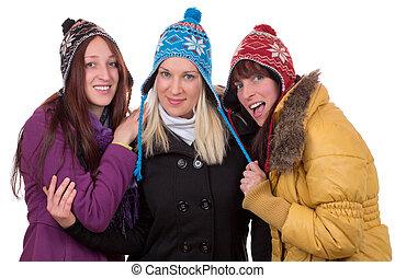 grupo, de, mulheres felizes, em, inverno, com, luvas, echarpe, e, bonés