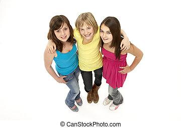 grupo, de, três, meninas jovens, em, estúdio