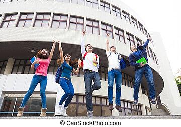 grupo, estudiantes, joven, juntos, saltar, feliz