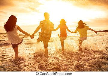 grupo, pessoas, jovem, praia, tocando, feliz
