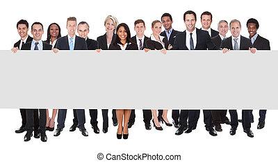 grupp, av, businesspeople, med, affisch