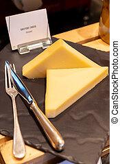 gruyere Cheese - gruyere cheese on black stone plate in ...