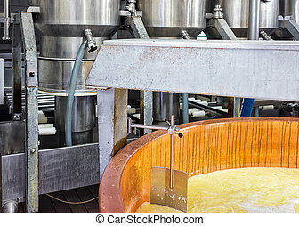 Gruyere de Comte Cheese Processing in dairy in France - ...